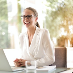 laughing businesswoman working in office with laptop 3756679
