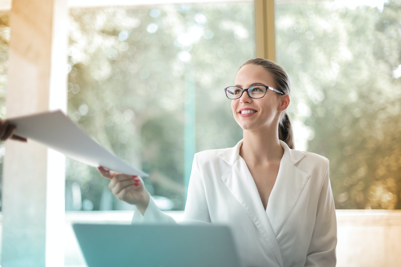 positive businesswoman doing paperwork in office 3756678
